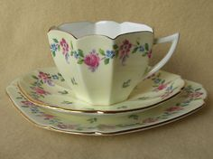 ART DECO Vintage Shelley Queen Anne shape china tea cup and saucer trio ~ Pink and blue floral motif on cream with gilt trim.