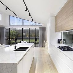 Bright beautiful kitchen 😍 ・・・ Loving the lines in this kitchen by with the raked ceiling, track lighting and steelframe doors. Kitchen Lighting Design, Modern Kitchen Design, Interior Design Kitchen, Track Lighting In Kitchen, Roof Design, Window Design, Küchen Design, Open Plan Kitchen Living Room, Open Plan Living