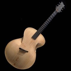 The acoustic guitar gets its first significant design mod in 180 years! - Picture an acoustic guitar and what do you see? The classical… Wood Turning Lathe, Wood Turning Projects, Wood Projects, Popular Woodworking, Diy Woodworking, Bunker, Acoustic Guitar Case, Archtop Guitar, Yanko Design
