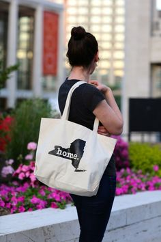 The Home. T - New York Home Tote Bag. Portion of profit donated to multiple sclerosis research.
