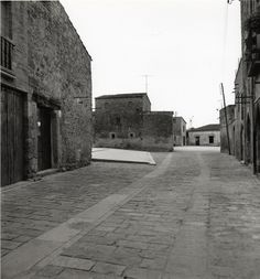 Paving works in the medieval town of Ullastret, Girona, Spain. 1982-85. Square in front of the church of Ullastret. Arch: Josep Lluis Mateo