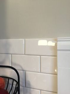 SW Agreeable Gray wall paint with warm gray grout on subway tiles White Subway Tiles, Subway Tile Kitchen, Kitchen Backsplash, Backsplash Ideas, Kitchen Cabinets, White Tiles Grey Grout, Subway Tile Colors, Herringbone Backsplash, Subway Tile Backsplash