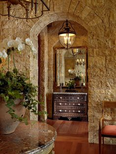 Tuscan-inspired home on the Aspen mountains. stone walls..love the arches