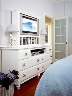 if you want a tv in the bedroom I like this built in option over the dresser.  could DIY and just take out top middle drawer of a standard dresser and upgrade it with new paint and hardware... I like this...