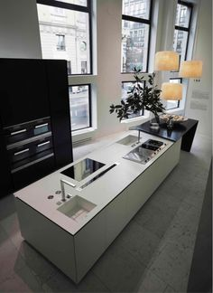 The Sharp kitchen of Poliform Varenna designed by Daniel Libeskind. It uses DuPont™ Corian® high- tech surface in the Glacier White colour for the worktop and the sinks; the new black colour of DuPont™ Corian® called Deep Nocturne.