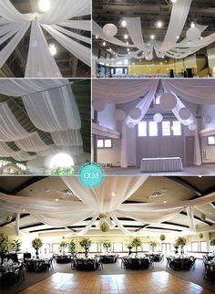 Une idée déco classique mais pas si courante, les drapées au plafond. Si vous organisez votre mariage dans une salle des fêtes, c'est la solution idéale pour camoufler des plafonds pas très jolis. On utilise souvent des voilages transparents, du tulle, de l'organza ou de l'intissé. Vous pouvez acheter ces tissus n'importe où. Pour mon mariage j'avais