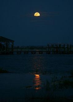 A shy supermoon from Brick Landing, North Carolina USA. Credit: Tavi Greiner.