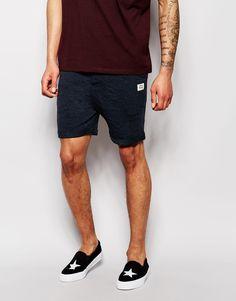 Shorts von Jack & Jones Sweatshirt-Stoff Kordelzug in der Taille Reißverschluss schräge Seitentaschen Umschlag schmale Passform, sitzt eng am Körper Maschinenwäsche 65% Baumwolle, 35% Polyester Model trägt Größe M und ist 188 cm/6 Fuß 2 Zoll groß