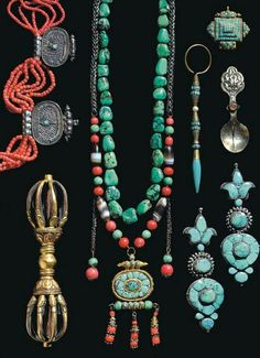 Tibet | An assortment of jewellery and ritual objects; the lot included: silver Gau boxes inlaid with turquoise; the earrings set with green and blue turquoise; ceremonial spoons in silver with stones; a turquoise pendant; 2 strands of rare tibetan turquoise beads one complete with gau box; a bracelet strung with dzi beads, coral and turquoise; two tinder pouches; a fine multi strand coral necklace with 5 silver filigree pendants and ornate bronze vajra | 9,600$ for the lot ~ sold (03/2005)