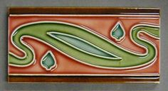 """Maw and Co tubelined dust pressed tile with an abstract Art Nouveau border design, tubelined in white with brown, red, green and blue coloured glazes, 6"""" x3"""", c1910. There should be another tile to work with this design to create a continuous border."""