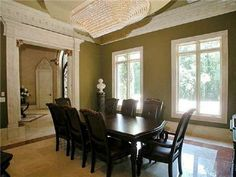 This dining room is exceptional! The crown molding and chandelier makes it feel so lavish and special.