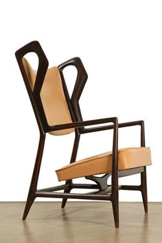 Triennale Armchair, 1951, by Gio Ponti | Along with building projects like the elegant Villa Planchart in Caracas, Ponti designed a number of now-iconic products, including the lightweight Superleggera chair and the curvy La Pavoni coffee machine of 1948. He was an enthusiastic leader of the post-war reconstruction, and a major influence on younger designers including Alessandro Mendini and Ettore Sottsass. #furniture #chair #midcentury #design
