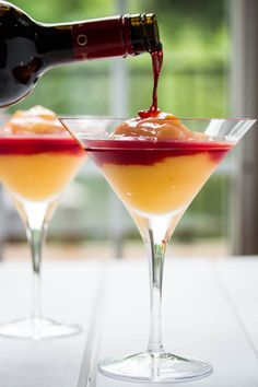 Made with real frozen peaches blended up with sweet peach liqueur and some ice, our homemade raspberry liqueur and topped off with a splash of red wine.  Its a gorgeous looking cocktail and tastes as good as it looks. #blendedcocktail #milestonesbellini #peachcocktail