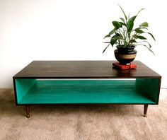 Mid Century Modern Coffee Table in Espresso and Teal Coffee Table Pictured L 48 x W 20 x H 16 Shelving Space: 8.5 x 16 This handcrafted Mid Century Modern coffee table is made from Pine Select. Its finished with homemade stain and several protective coats of satin polyurethane.