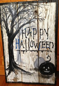 Halloween hand painted decorative sign, on restored old wood fence.