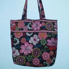 Vera Bradley Brown/Pink floral Tote. 12 x 13 x 3.5 Vera Bradley Brown/Pink/Purple floral tote. 12 x 13 x 3.5. 1 corner shows light wear. Not noticable.  Quilted. 1 Interior pocket. Button closure Vera Bradley Bags Totes