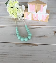 This cute mint green nursing necklace will keep your little one entertained for hours- a great distraction for those restless, inquisitive and curious babies while feeding!  This necklace is made from 100% food-grade silicone beads. The necklace is complete with a strong 60cm satin nylon cord and features a safety breakaway clasp, designed to pop open when pulled and tugged on. With a variety of textures, colours and materials bubs will sure love this necklace on his Mamma! Nursing Necklace, Beaded Necklace, Necklaces, New Mums, Teething, Food Grade, Mint Green, Cord, Safety