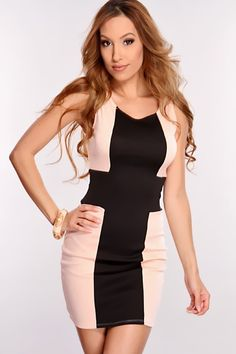 Look simply fabulous no matter the occasion with this dress. You can either dress it up or down. No matter what youll look your absolute best. Its definitely a must have in your wardrobe. It features two tone, cross design, scoop neck, sleeveless, and fitted. Model is wearing a small. 96% Polyester 4% Spandex.