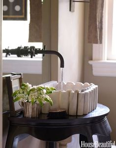 Pounds designed a leggy console to hold her bathroom sink instead of a traditional closed cabinet. The open space helps to make the bathroom feel larger.