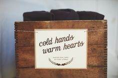 """""""cold hands, warm hearts"""" sign at the wedding.  Outdoor wedding when it's chilly? Provide a few shawls for your guests :)"""