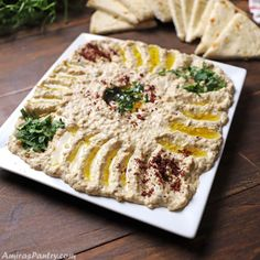 Mutabal dip in a white square plate garnished with sumac and chopped parsley. Middle Eastern Dishes, Middle Eastern Recipes, Wine Recipes, Snack Recipes, Snacks, Egyptian Food, Egyptian Recipes, Tapas, Full Fat Yogurt