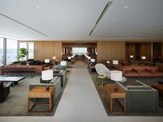 Warm, natural materials such as wood and stone, enhanced by soft acoustics lighting create a comfortable environment at our Haneda lounge in Tokyo.