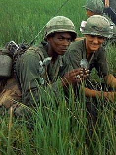 A patrol of US soldiers from the 9th Division in a leech infested rice paddy field in the Tan An Delta, Vietnam, 1968.   The rice paddies with their quilt like patterns of water filled fields made movement difficult and were commonly used to set booby traps, particularly on the paths along the edges. The elephant grass surrounding the fields was difficult to get through and was high enough and thick enough to hide an entire military unit waiting to make an ambush.  The Vietnam War