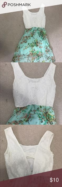 High low floral lace dress Top is a white lace with a rose design with a cut out in the back. The skirt is a high low that is a sheer material with a blue skirt underneath. Dresses High Low