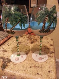 Hand painted beach scene wine glasses.  The sand and shells are from Clearwater beach, where the couple these glasses are for, got engaged.