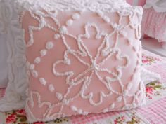 vintage chenille patchwork pillow made from only the best vintage chenille bedspreads in shades of pink and white with a floral center surrounded by popcorn pearls.