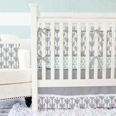 Caden Lane Gray Arrow Crib Bedding is sold as a bumper-less two piece set (bumpers available separately) and features a modern color palate combined with bold geometric prints.