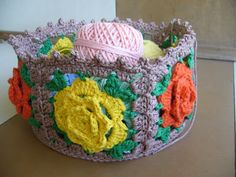 DIY: Crochet Rose Basket...not a pattern so much as a tutorial on how to make the basket with squares of your choice. I really like this for project storage!