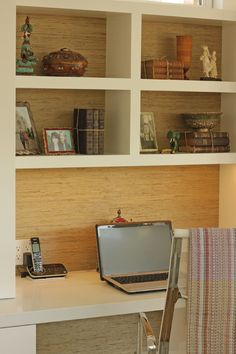 Built in desk with contrasting wall color or textural paper behind.