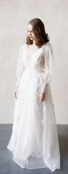 """Silk Organza """"Sovay"""" wedding dress. Poet sleeves with pearl button detail cuff and deep v neckline. made in the UK by Ailsa Munro photo by Lottie Ettling #OrganzaWeddingDress #HandmadeWeddingDress"""