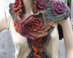 Unique Crochet scarf Freeform Crochet Scarf, Roses, Capelet, Neck Warmer Brown Orange blue Green,Chunky Knit ,Freeform Crochet, one of a kind Color: shadows brown/green/orange/blue Size: One size fits all lenght about 31,10/9,45 (79cm/24cm) materials used: 100% acrylic premium Care instruction: hand wash using warm water. Because of different monitors and screen resolutions, colors may look different on the screen than really.