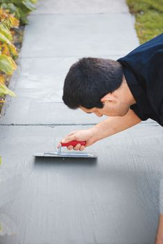 Trowel concrete resurfacer over your worn walkway, and you'll have a brand new, durable surface with uniform color; How to repair a worn or spalled concrete surface
