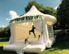 Wedding Bouncy Castle Trend The latest news on Wedding Planning is on POPSUGAR UK. On POPSUGAR UK, you will find news on entertainment, celebrities and Wedding Planning. Cute Wedding Ideas, Wedding Games, Wedding Trends, Perfect Wedding, Wedding Inspiration, Wedding Tips, Wedding Stuff, Wedding With Kids, Unique Wedding Themes