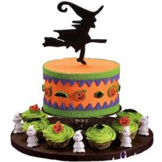 Conjure up a spooky sweet table with ease! Easy to decorate cupcakes and a shadowy color flow witch hovers above a simple, colorful cake.