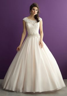 This ballgown embodies the best of all bridal trends — lace, tulle, cap sleeves and sparkling crystal beadwork.