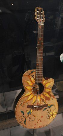 A sunflower inspired painted guitar.