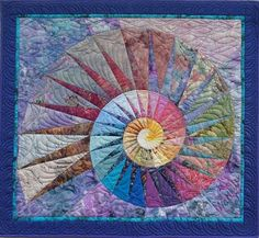 """1996, """"Nautilus"""", a 124 cm x 134 cm large patchwork quilt, by Martha Roggli. The website has several other paper-pieced spiral quilts."""