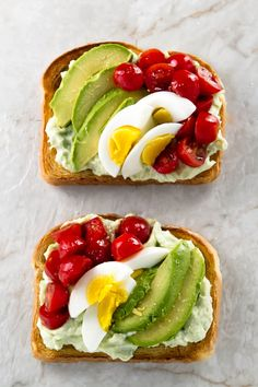 Loaded avocado ricotta toast topped with creamy ricotta cheese, avocado, fresh tomatoes, and hard-boiled eggs. A great way to start the day!