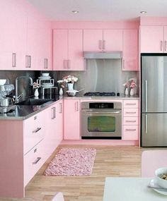 23 Girly Chic Home Decor Ideas for a Ladylike Home - An unapologetically feminine pastel pink kitchen with stainless steel appliances and counter tops