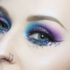 This is how we rock our #mondayblues! In  with this blue-to-purple rainbow and #glitter #makeup look by our #mua @marioncameleon.   #makeupforever #makeupforeverprotribe