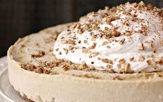 pumpkin cheesecake with a cinnamon maple coconut whipped cream