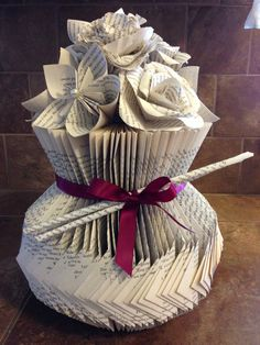 """This vase fold is on my """"Book Art Tutorial"""" board, but I decided to make it a little different and show the corner folds. All the tutorials for the flowers are on my """"Book Art Tutorial"""" board, too."""
