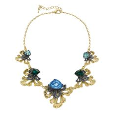 -Le Rococo Statement Collar Necklace- Dramatic Rococo-inspired design, featuring hand-cut asymmetric glass in tonal blue hues, rich mixed-plating, and clear crystal pave on ornate fan-shaped petals. This vibrant, sparkling statement necklace beckons for a night out on the town.