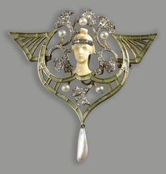 An art nouveau diamond, pearl, green enamel, platinum and eighteen karat gold pendant brooch, Georges Fouquet,