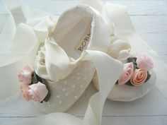 oh my goodness - ivory satin baby ballet shoes with swarovski crystals. . . fit for royalty for sure.