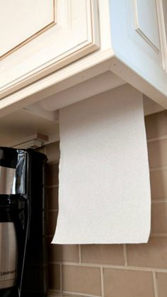Pretty sure any cheap paper towel holder can be used this way. hidden paper towel holder from MasterDesignCabin. House Design, Home, Kitchen Remodel, Home Remodeling, Home Kitchens, Home Diy, Storage, Kitchen Renovation, Kitchen Design